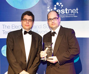 Huw Rees (on the right of the picture) Chief Technology Officer at Vizolution collecting the award.