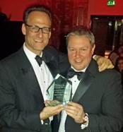 Vizolution CEO Bill Safran (left) and Glenn Lindsay, Director, Telephone Distribution at Santander with the award.