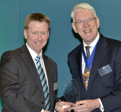 Darren Kelly ACSI of Isle of Man receiving his award from Sir David Howard FCSI(Hon), Chairman and Managing Director, Charles Stanley & Co Ltd.