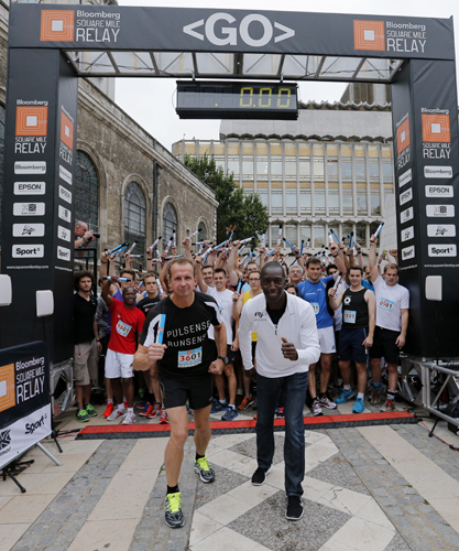 Michael Johnson and Greg Whyte line up at the start of the Bloomberg Squ...