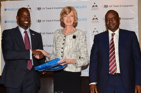 The Capital Markets Authority Acting Chief Executive, Mr Paul Muthaura (left), and the Lord Mayor of the City of London, Alderman Fiona Woolf (centre), exchange documents after signing the Memorandum of Understanding (MOU) between the Capital Markets Authority and the Chartered Institute of Securities & Investment in Nairobi today. Looking on is the Cabinet Secretary to the National Treasury, Mr Henry Rotich (right). The MOU paves the way for the introduction of international certification standards for the capital markets in Kenya and the region.