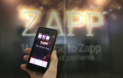 Zapp app on iphone against Zapp logo background