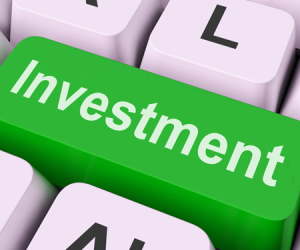 investment key shows investing wealth and roi