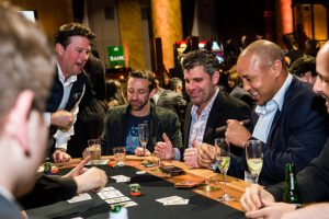 John Sabat, New York Knicks Legend John Starks and JR Havlan, Writer from the Tonight Show Starring Jimmy Fallon and 8-time Emmy Award winning writer for The Daily Show with Jon Stewart, at the StreetWise Partners Raising the Ante Charity Poker Tournament and Casino Event on March 11, 2015 in New York City. Photo by Brooke Ismach