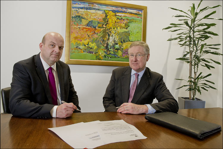 Simon Hayden(left) from Clydesdale and Yorkshire Bank and David Godfrey, who is chief executive of UK Finance signing a deal to make UKEF s services available to Clydesdale and Yorkshire Bank's customers.