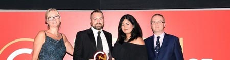 Philip Brennan and Kareema Ali collect the award for B2B E-Commerce Website of the Year