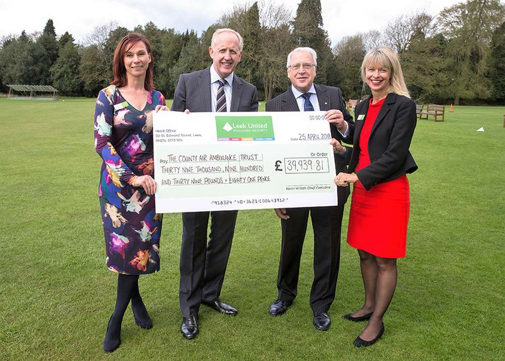 Arthur Worthington, County Air Ambulance Trust Admninistrator (second from right), receives Leek United's Affinity Account donation from Chief Executive Kevin Wilson, Society Chair Rachel Court (right)