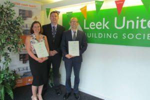 Jo Cordall and Craig Milner receive their 'Effective Coaching' certificates from David Roberts (centre), of Buxton & Leek College.