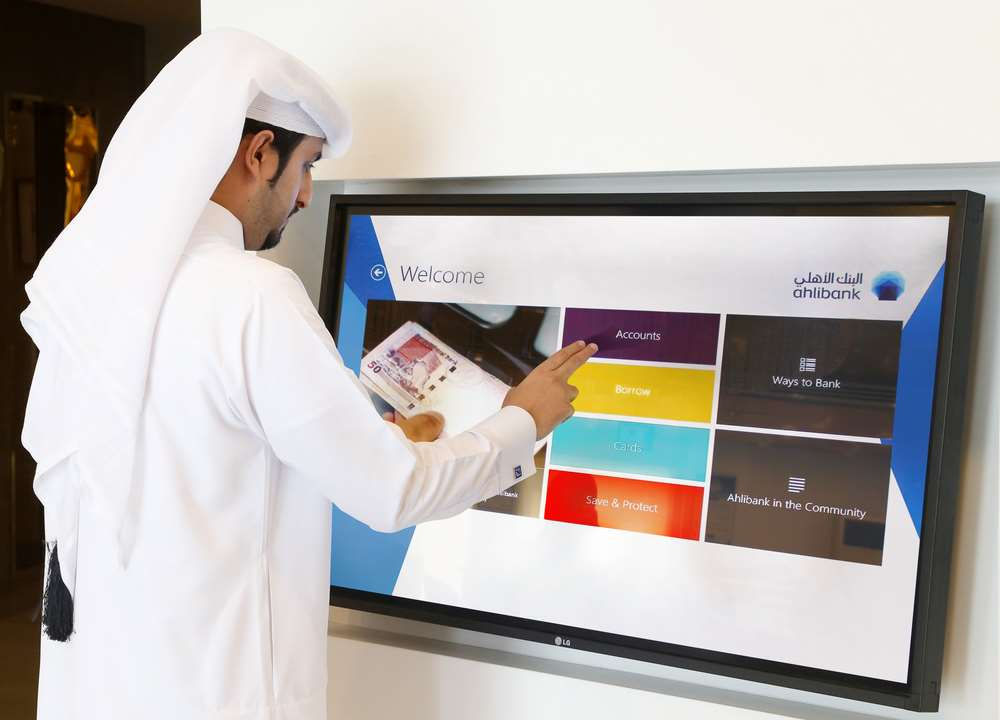 Ahlibank's modern technology including interactive touch screens designed to enhance the customer experience