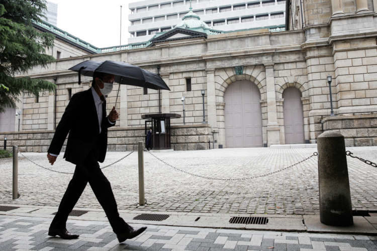 Bank of Japan lifts next year's growth forecast, saves ammunition as virus risks linger 10