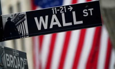 Stocks at new peaks on stimulus hopes, dollar slips 13