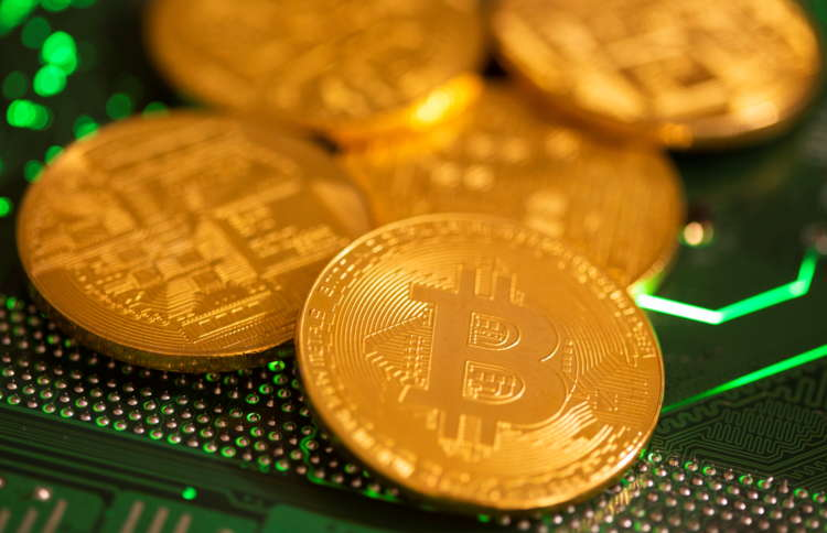 Bitcoin slumps 10% as pullback from record high gathers pace 12