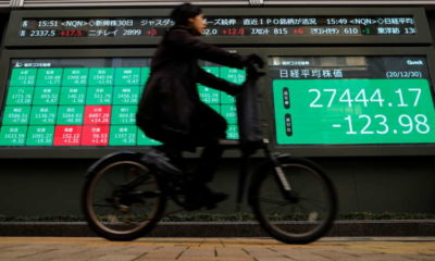 Asian markets step back from stimulus-driven record highs 7