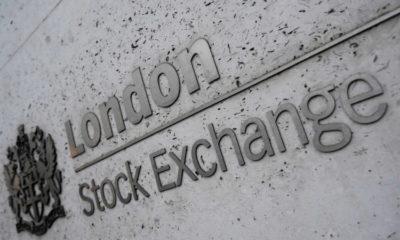 Weak data, earnings drag stocks lower; oil falls 9