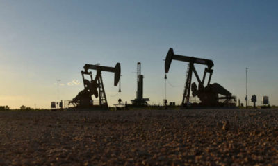 Oil prices edge up, but lockdowns restrain gains 10