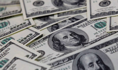 Dollar rises on risk aversion, Fed cautious on economic recovery 16