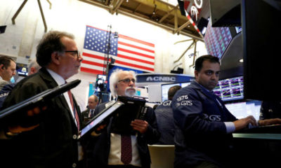 Stocks tumble on recovery fears; dollar climbs 12