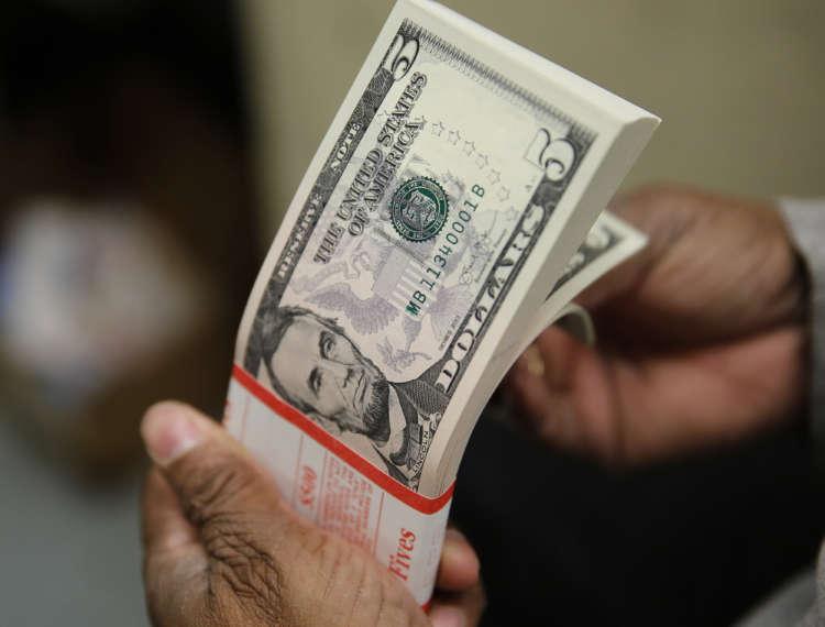 Dollar steady, yen dips on month-end rebalancing 12