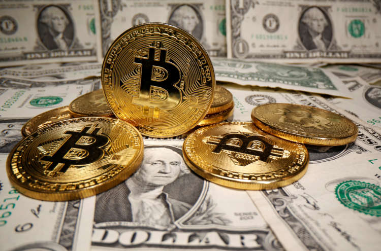 Dollar held down by doubts over pace of U.S. recovery; bitcoin retreats from record high 12