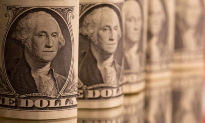 Dollar gains on higher yields, risky currencies weaken 12