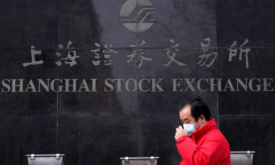 Surging bond yields push Asian shares to one-month lows 21