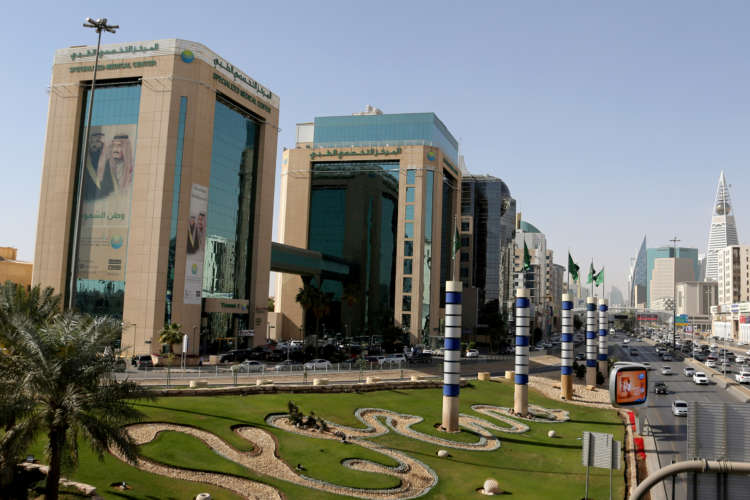 Analysis: With stick and carrot, Saudi starts winning over firms in regional race