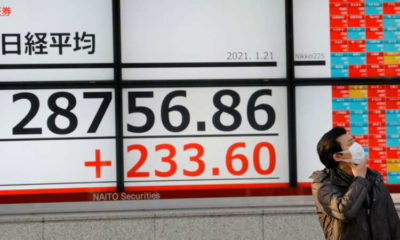Asia stocks unsettled by yields and oil, Nikkei hit by BOJ shift
