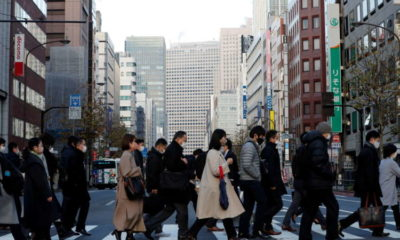 Japan downgrades fourth-quarter GDP as companies scale back spending