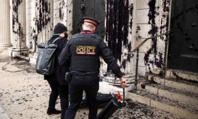 Climate activists splash black dye on Bank of England 7