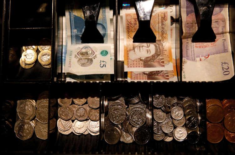 Sterling slips after reaching two-week high versus dollar 5