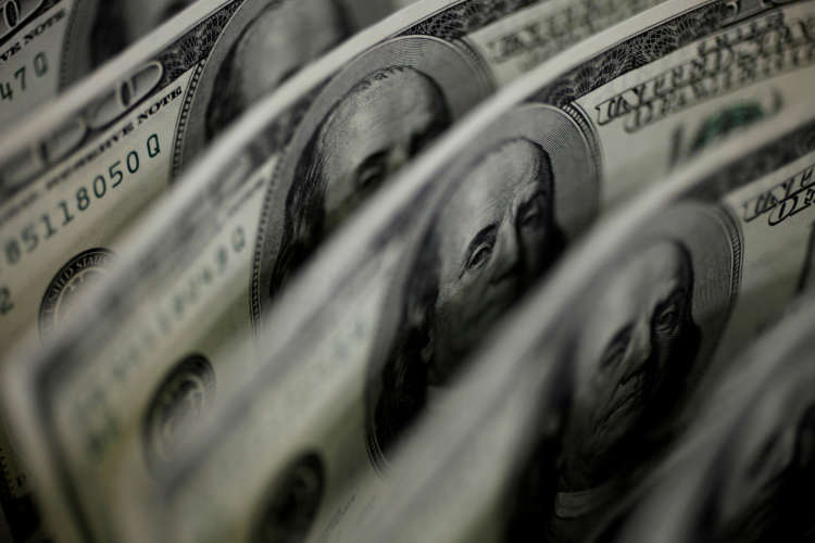 Dollar at two-week low as U.S. yields slip on reduced Fed tightening bets 1