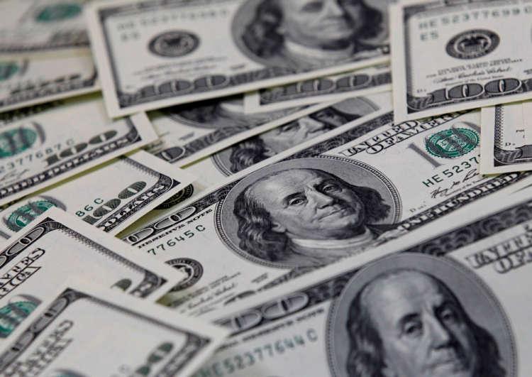 Dollar edges higher as data helps lift Treasury yields 1