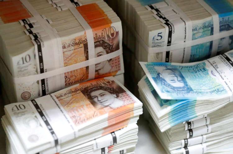 Sterling rises 1% vs dollar at start of data-heavy week 1