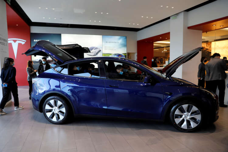 Tesla rallies after Canaccord upgrades rating, says it is like Apple 1