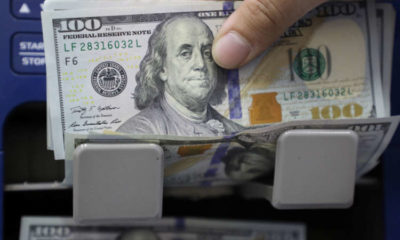 Dollar hits four-week low as Fed's dovish message gains sway; rouble sinks 14
