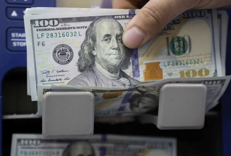 Dollar hits four-week low as Fed's dovish message gains sway; rouble sinks 15