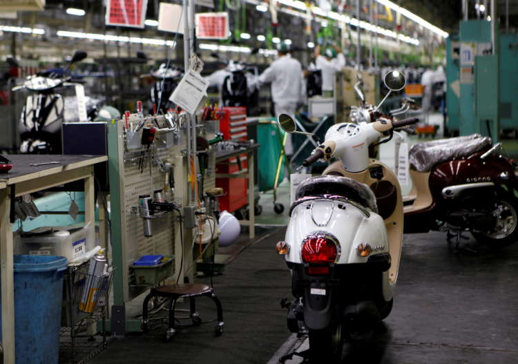 Japan manufacturers' mood hits two-year high on chip demand: Reuters Tankan 1
