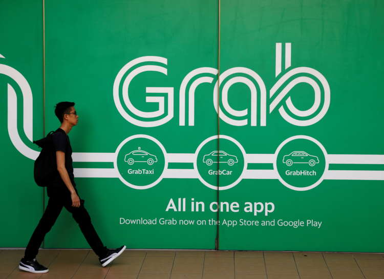 Grab mulling secondary Singapore listing after SPAC merger -sources 1