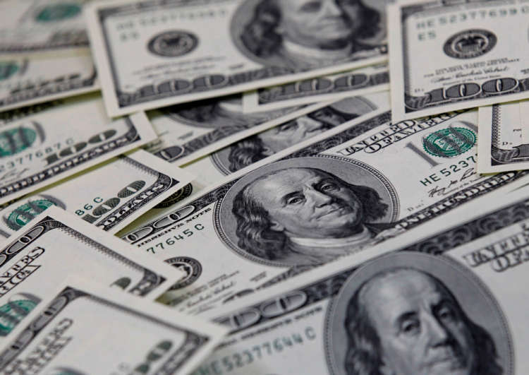 Dollar advances after U.S. data, but on track for largest monthly fall since July 1