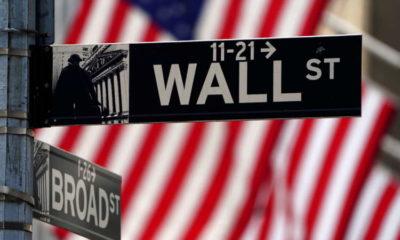 World shares off record peak; dollar rises 9