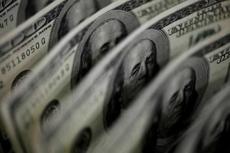 Dollar at four-week low on retreating Treasury yields