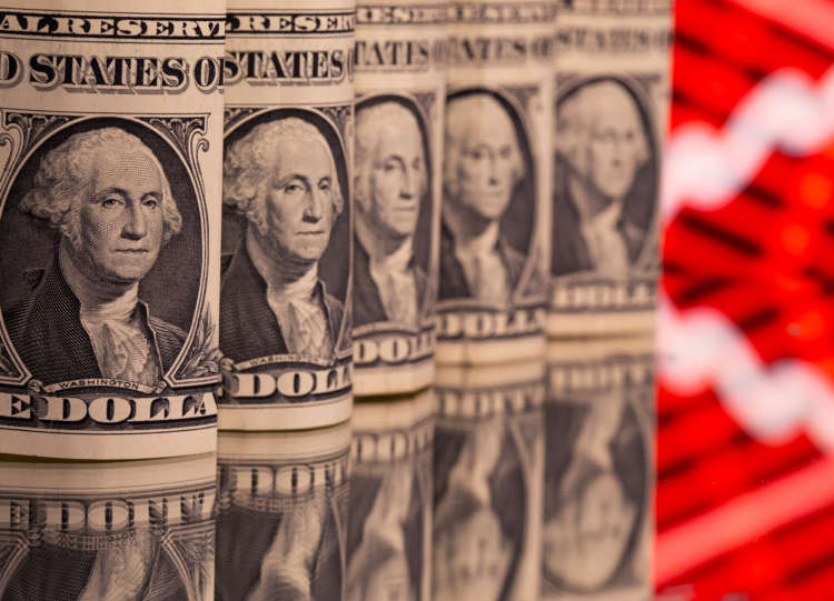 Dollar grinds lower on bets U.S. tapering remains distant