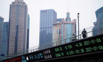 Asian shares mixed as earnings fail to inspire before Fed