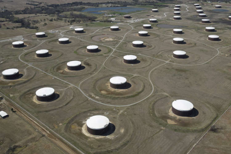 Oil inches lower on concerns over COVID-19 surge in India, Japan