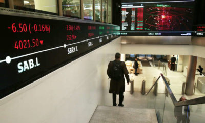 AstraZeneca, Smurfit Kappa pull FTSE 100 higher; Darktrace soars on debut