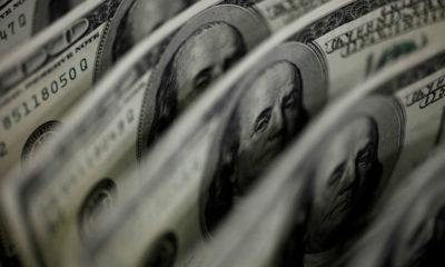 Dollar edges up as markets wait for U.S. inflation data