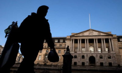 Bank of England sees faster economic rebound, slows its bond buying 1