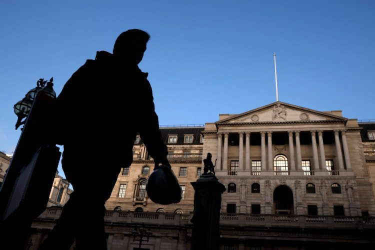 Bank of England sees faster economic rebound, slows its bond buying 2