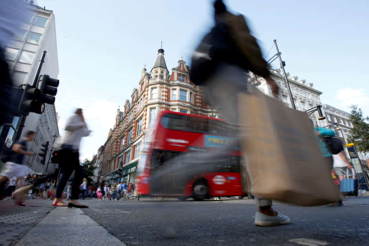 Rain and cold drives UK shopper numbers lower