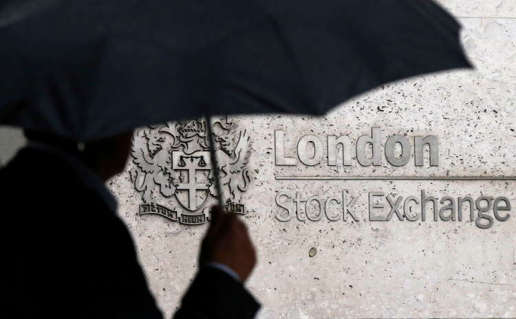 FTSE 100 slips as energy, industrial stocks weigh; Diploma jumps